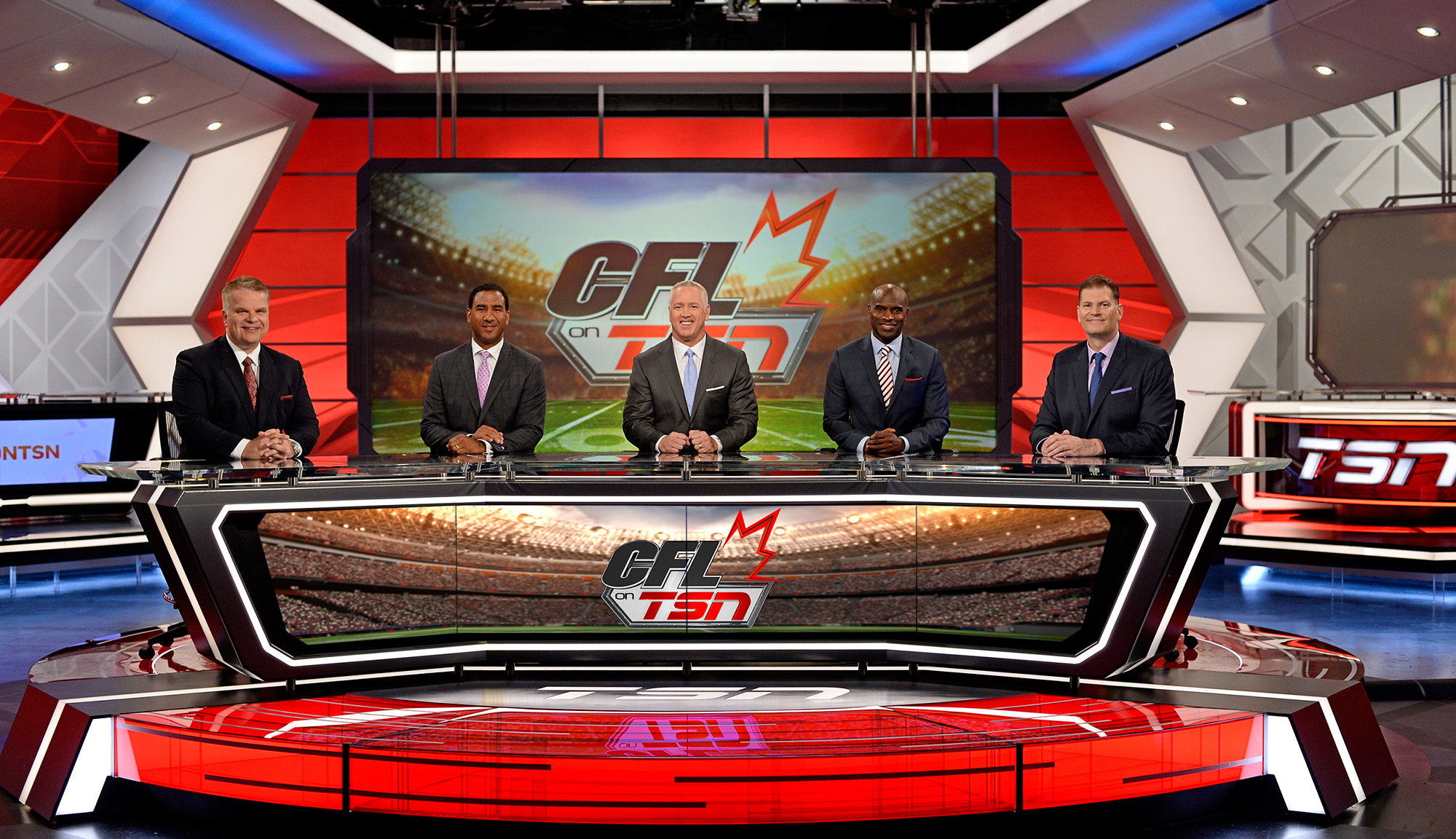 TSN's popular CFL ON TSN panel is back for the 2015 season. (L-R) Host Rod Smith alongside analysts Jock Climie, Matt Dunigan, Milt Stegall, and Chris Schultz. DOWNLOAD PHOTO: http://bit.ly/1RtUg9M