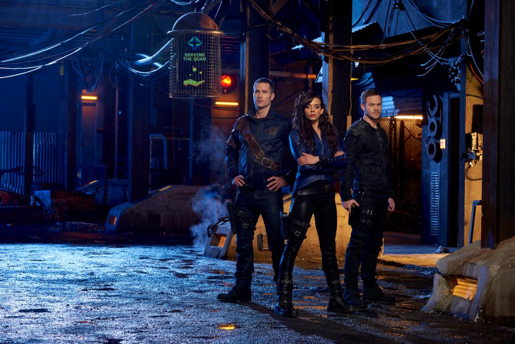 D'avin (MacFarlane), Dutch (John-Kamen) and John (Ashmore) gear up for another round of killer action with Season 2 of KILLJOYS