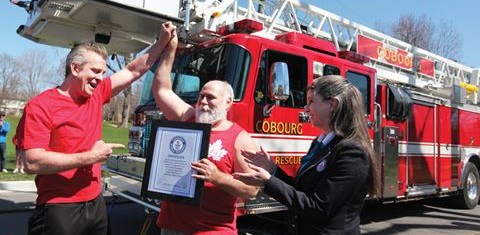 COBOURG -- Discovery Channel host Andrew Younghusband, left, joined local strongman Rev. Kevin Fast to set a Guinness World Record by pulling three fire trucks more than 100 feet along Queen Street. The record pull of 82,550 kilograms was made during the filming of Andrew's new show, 'Tougher Than it Looks?' April 23, 2016.