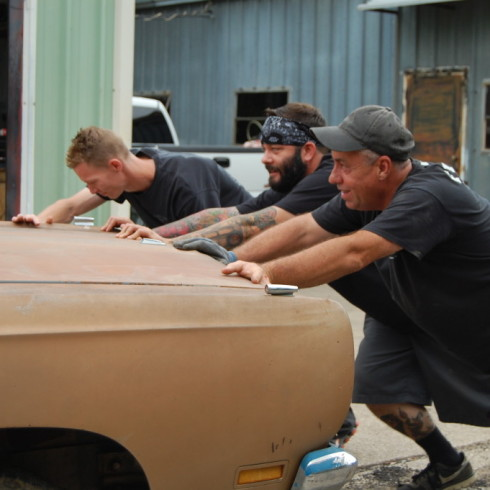 Soupbone, Kevin Clark and Tom Smith loading the Plymouth into the garage.