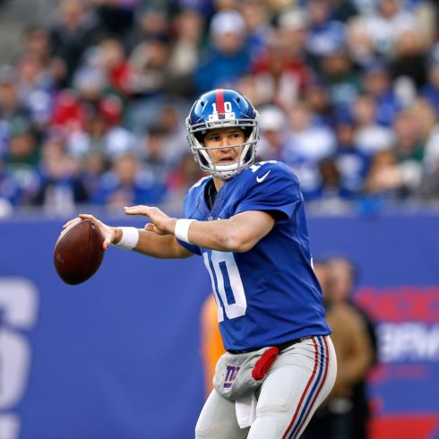 New York Giants quarterback Eli Manning (10) throws a pass during an NFL football game against the New York Jets on Sunday, Dec. 6, 2015 in East Rutherford, N.J. The New York Jets won 23-20 in overtime. (Aaron M. Sprecher via AP)