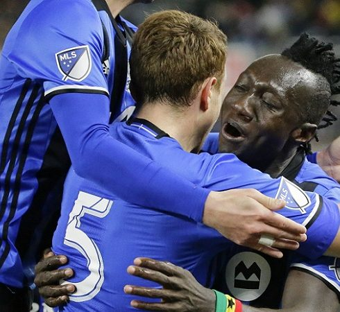 Montreal Impact's Dominic Oduro (7) and Wandrille Lefevre (5) celebrate with teammates after Oduro scored a goal during the second half of an MLS soccer game against New York City FC, Wednesday, April 27, 2016, at Yankee Stadium in New York. The game ended in a 1-1 tie. (AP Photo/Frank Franklin II)