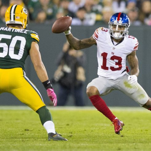 Oct 9, 2016; Green Bay, WI, USA;  New York Giants wide receiver Odell Beckham Jr. (13) rushes with the football as Green Bay Packers linebacker Blake Martinez (50) defends during the third quarter at Lambeau Field.  Green Bay won 23-16.  Mandatory Credit: Jeff Hanisch-USA TODAY Sports